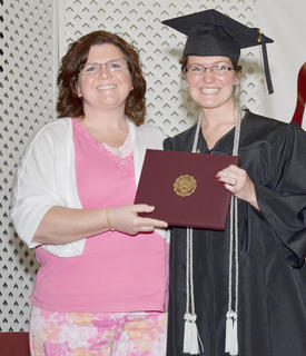 Rachel Moran of Campbellsville smiles as her mother, Christine Moran Cundiff, presents her daughter with a Bachelor of Social Work degree.