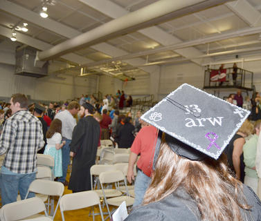 Ashley Wilson of Russell Springs decorated her cap on Saturday with her initials. Wilson received a Bachelor of Science degree in middle grades education.