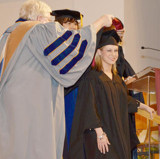 DeLisa Martin Richards of Campbellsville is hooded as she receives her master's degree in business administration.