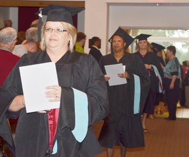Melissa Collison of Campbellsville, who received a master's degree in special education, leads her fellow graduates into Ransdell Chapel on Friday.