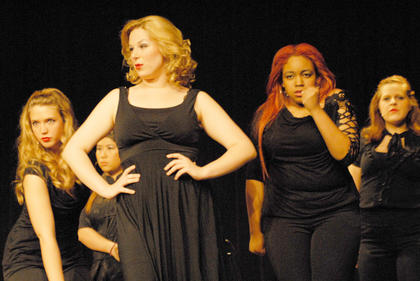 "From left, Holly Davidson of Danville, Julia Tan of Malaysia, partially hidden, Singrid Tipton of Lawrenceburg and Alia McClendon and Bella Jeffrey of Campbellsville perform ""Cell Block Tango."""