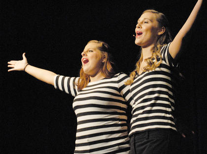 From left, Bella Jeffrey and Lacy Mudd of Campbellsville perform &quot;Anything Goes.&quot;