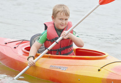 Above, Dylan Neal of Campbellsville takes his turn in a canoe at Camp Kentahten.