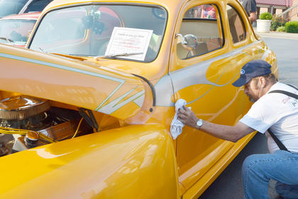 Mike Kessinger of Campbellsville shines his 1941 Ford Coupe at the annual car show at Campbellsville University, hosted by Tri-County Car Club.