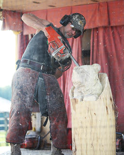 Chainsaw carver Dennis Beach conducts a demonstration for spectators at the Taylor County Fair on Monday.