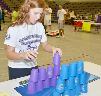 Sydney Jeffries sees how fast she can stack cups.