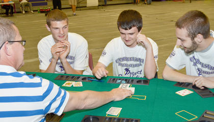From left, Michael Rafferty, Jeremy Dearing and Gavin Graham play blackjack at Project Graduation.
