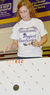 Sydney Jeffries takes her chances at the plinko game.