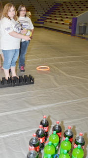 Samantha Berry takes her chances at the ring toss, while Sheila Waldren waits her turn.