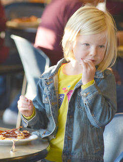 Makenna Franklin enjoys the breakfast buffet on Saturday morning.