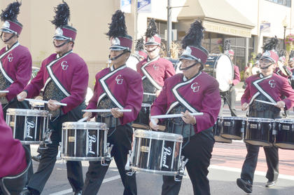 CU Tiger Marching Band drummers perform during Saturday&#039;s Homecoming parade. The band is celebrating its 20th anniversary.