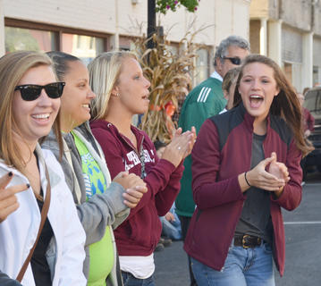 CU student Sarah Akers cheers during Saturday's Homecoming parade.