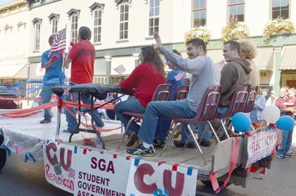 Members of the Student Government Association group wave to the crowd from their float.