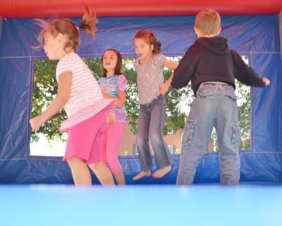 Area children bounce in an inflatable house at Saturday&#039;s Homecoming festival.