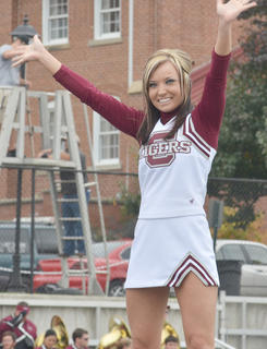 CU cheerleader Ashley Bates cheers for the Tigers during Saturday&#039;s Homecoming game.