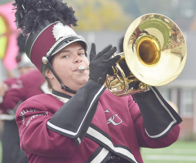 Rebecca Oliver of Scottsville plays the horn with the CU Tiger Marching Band during Saturday&#039;s Homecoming parade. The band is celebrating its 20th anniversary.