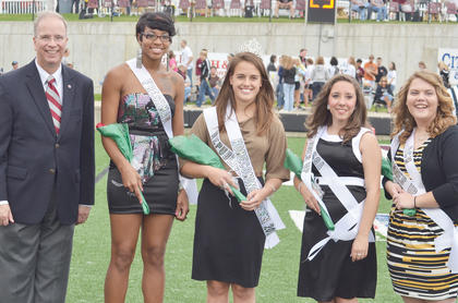 Dr. Michael V. Carter, president of Campbellsville University, left, poses with this year's Homecoming court. From left are Carter; Keisha Chiles of Louisville, freshman attendant; Emily Shultz, Homecoming queen, a senior from Mt. Sterling representing College Republicans; Kaylynn Best, first runner-up, a senior from Harrodsburg representing Student Government Association; and Maribeth Milburn, second runner-up, a senior from Lawrenceburg representing Baptist Campus Ministries.