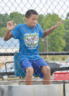 Devin Williams of Taylor County braces himself before he is submerged in water at the Family Fun Zone dunk tank.