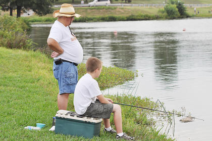 Josh Dooley, 10, and his father Ronnie have a prime spot on City Lake for fishing.