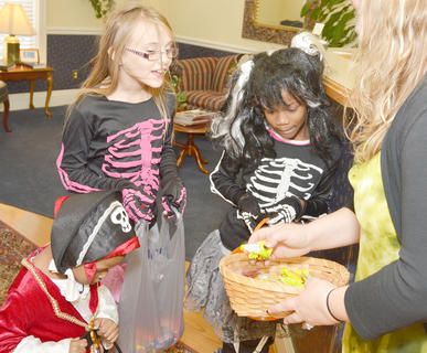 Trick-or-treaters get candy from Nunery & Call PLLC law firm.