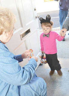 Abby Ross, 3, originally from New Orleans, trick-or-treats at The Green Room. Ross is staying in Campbellsville with family members, Amazon.com work campers.