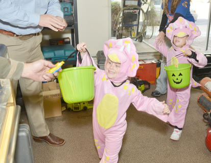 Trick-or-treaters ask for candy at Dixie Pawn &amp; Gun.