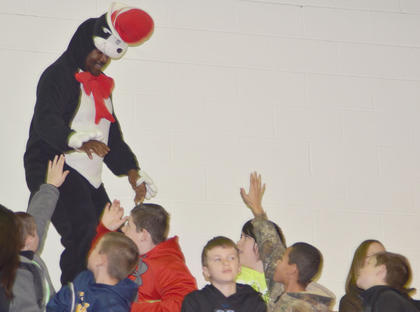 Students at TCES wave to The Cat in the Hat.