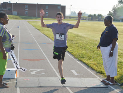 Brad Willis of Campbellsville crosses the finish line first at the 2k run/walk.