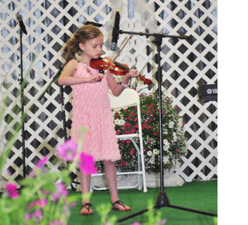 Rayne Taylor plays the violin during the Coca-Cola Talent Classic.