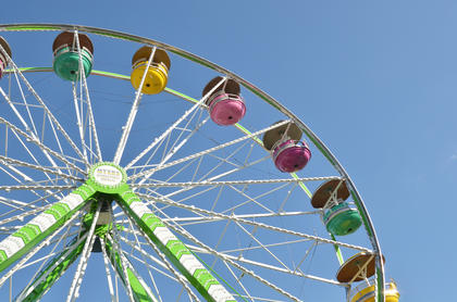 The Ferris wheel at the fair attracts a large crowd.