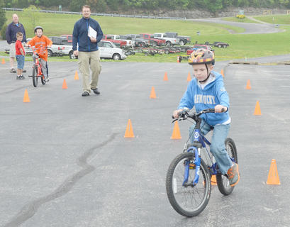 Collin Moore, 7, of Campbellsville, drives through an obstacle course during the bicycle rodeo.