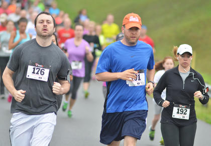 From left, Eric Sprowles, Greg Neat and Erin Estes participate in Saturday's race.