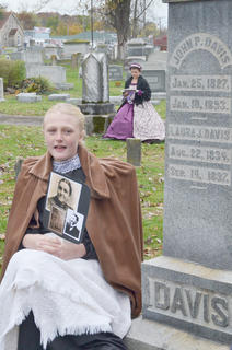 Abbie Dicken portrays the ghost of Laura J. Davis, the wife of John P. Davis.