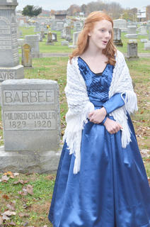 Madison Jones portrays the ghost of Mildred Chandler Barbee and tells the crowd about her life.