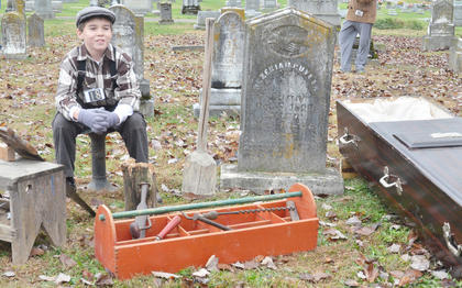 Cole Kidwell portrays the ghost of Hezekiah Puryear, who made coffins.