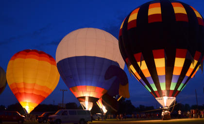 Hot air balloons light up the night at Tuesday nights balloon glow.