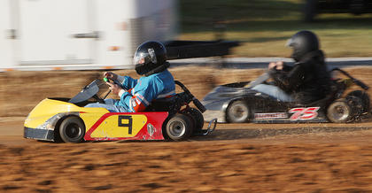 Racers compete during the GoKart races at the Taylor County Fair on Monday.