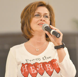 From the Heart member Debbie Lawson performs.