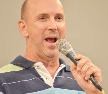 The Joymakers member Tim McClain sings.