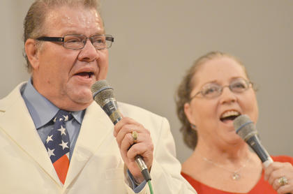 Polston Family founding members Garry and Lula Polston sing for the crowd.
