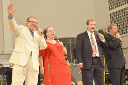 From left, Polston Family members Garry Polston, Lula Polston, Tracy Bertram and David Martin sing.