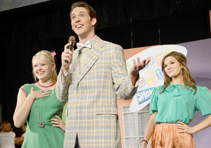 Singing, dancing and hairspray. Campbellsville University presented 'Hairspray' last week. In the play, pleasantly plump teenager Tracy Turnblad teaches 1962 Baltimore a thing or two about integration after landing a spot on a local TV dance show, the Corny Collins Show. Above, Dakota Rogers, playing Corny Collins, sings 'Nicest Kids in Town' on the Corny Collins Show with Megan Kist, left, of Radcliff and Natalie Warren of Campbellsville.