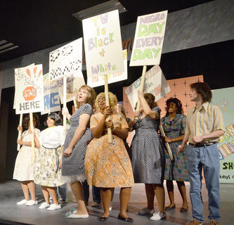 'Big, Blonde and Beautiful' is the song performed as the Baltimore students, with their mothers, protest segregation.