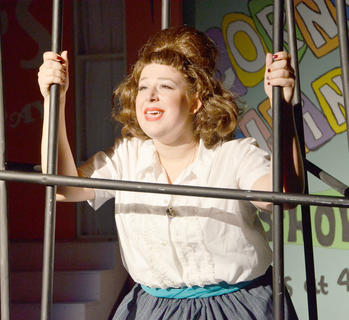 Singrid Tipton of Lawenceburg, who plays Tracy Turnblad, is in jail after the protest.