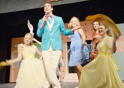 Dakota Rogers of Harrodsburg as Corny Collins performs with, from left, Megan Kist of Radcliff, Reagan Pollock of Campbellsville, Blair Lamb of Campbellsville and Rebekah DeVore of Louisville perform 'It's Hairspray' during the Miss Hairspray contest on the Corny Collins Show.