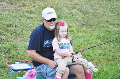 Four-year-old Clara Grace Fuller gets help from her grandpa, David Hayes, at City Lake.