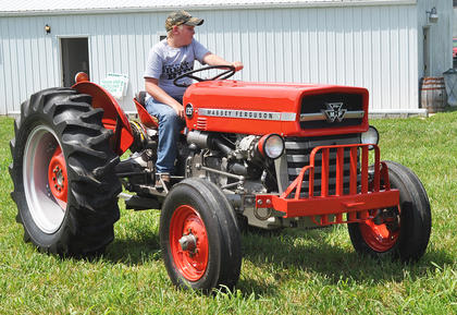Sam Baker waits to run his 1973 Massey Ferguson tractor through the obstacle course at the Russell Creek/Homeplace on Green River Antique Gas Engine and Tractor Show on Saturday.