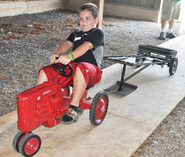 Brady Burton tests his endurance in the pedal tractor pull at the Russell Creek/Homeplace on Green River Antique Gas Engine and Tractor Show on Saturday.