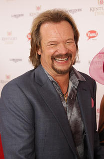Country singer Travis Tritt is interviewed as he walks the red carpet before Saturday&#039;s Kentucky Derby.