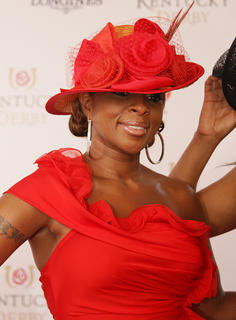 Singer Mary J. Blige walks the red carpet before singing the national anthem at Saturday's Kentucky Derby.